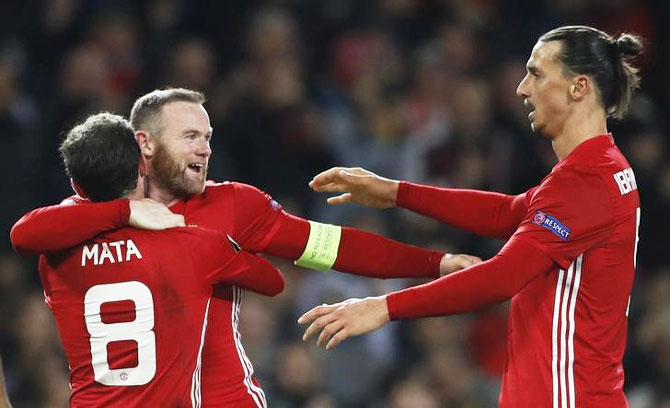 Manchester United's Juan Mata celebrates a goal with Wayne Rooney and Zlatan Ibrahimovic