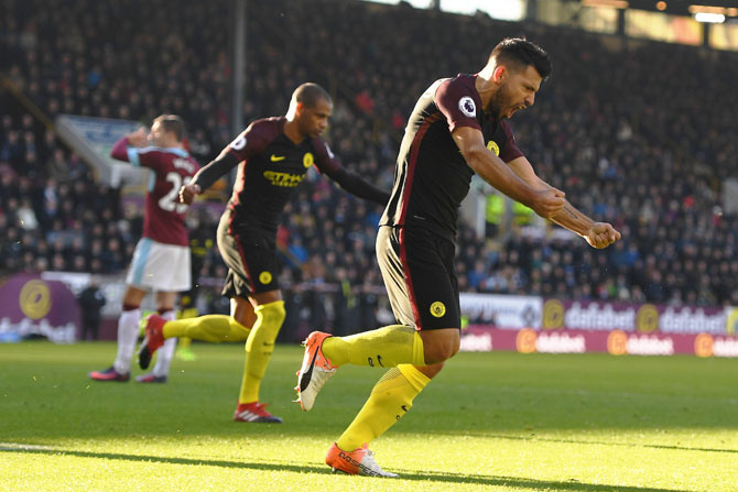 Manchester City's Sergio Aguero celebrates scoring his team's first goal against Burnley during their Premier League match at Turf Moor in Burnley on Saturday