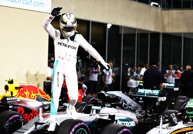 Lewis Hamilton of Great Britain and Mercedes GP waves to the crowd after qualifying on pole position during qualifying for the Abu Dhabi Formula One Grand Prix at Yas Marina Circuit in Abu Dhabi on Saturday
