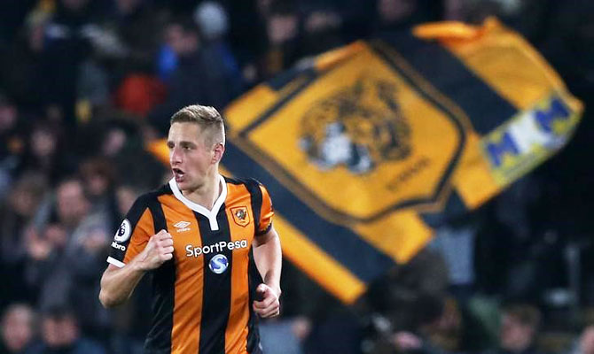 Hull City's Michael Dawson celebrates scoring against West Bromwich Albion during their English Premier League match at The Kingston Communications Stadium on Saturday