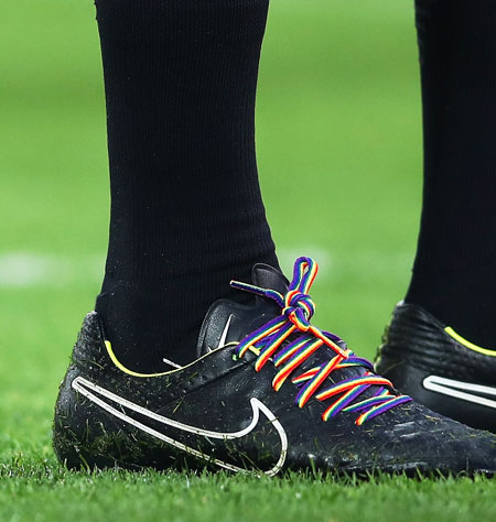 A match official wears rainbow coloured laces during the match between Liverpool and Sunderland on Saturday