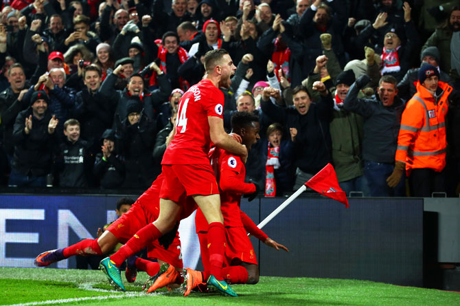 Liverpool's Divock Origi (1st right) celebrates with teammates on scoring the opening goal against Sunderland during their Premier League match at Anfield in Liverpool on Saturday