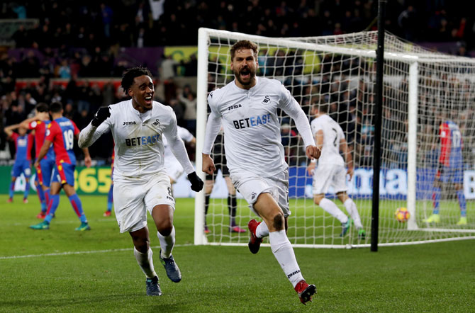 Swansea City's Fernando Llorente celebrates scoring his team's fifth goal during their Premier League match against Crystal Palace at Liberty Stadium in Swansea, Wales, on Saturday