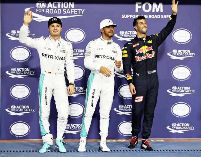 Top three qualifiers, Mercedes GP's Lewis Hamilton and Nico Rosberg with Red Bull Racing's Daniel Ricciardo in parc ferme after qualfying on Saturday