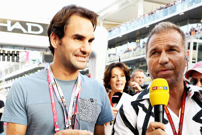 Tennis superstar and former World No 1 Roger Federer on the grid before the Abu Dhabi Formula One Grand Prix on Sunday