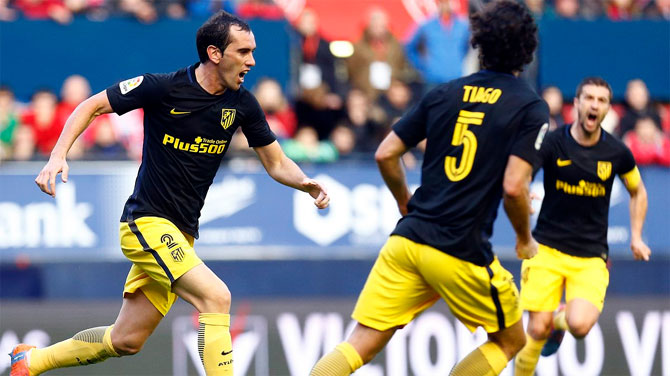 Atletico Madrid's Diego Godin celebrates a goal with teammates during their La Liga match against Osasuna on Sunday