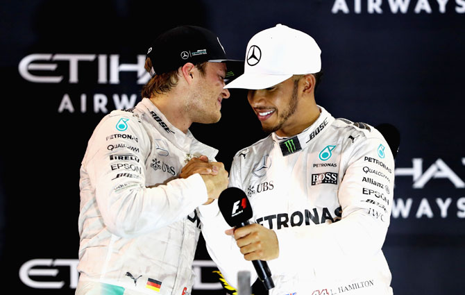 Race winner Lewis Hamilton congratulates second place finisher and World Champion Nico Rosberg of Germany on the podium