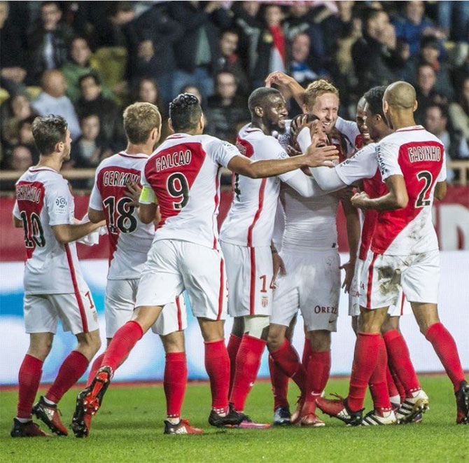 Players of AS Monaco celebrate a goal during the Ligue 1 match against Marseille on Sunday