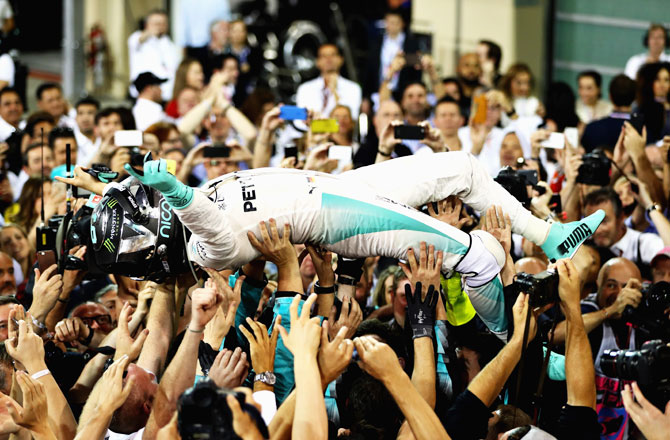Nico Rosberg of Germany and Mercedes GP celebrates after finishing second and winning the F1 World Drivers Championship during the Abu Dhabi Formula One Grand Prix at Yas Marina Circuit in Abu Dhabi, United Arab Emirates, on Sunday