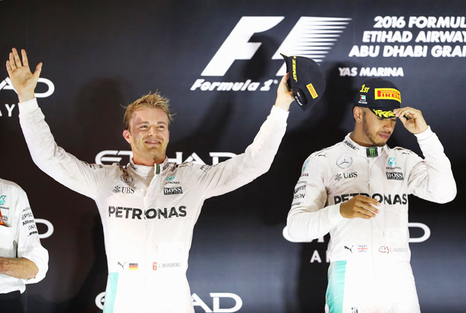 Race winner Lewis Hamilton and second place finisher and Championship winner Nico Rosberg on the podium following the race