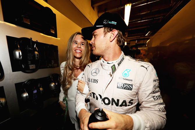 Nico Rosberg celebrates with wife Vivian Sibold after his F1 title triumph on Sunday