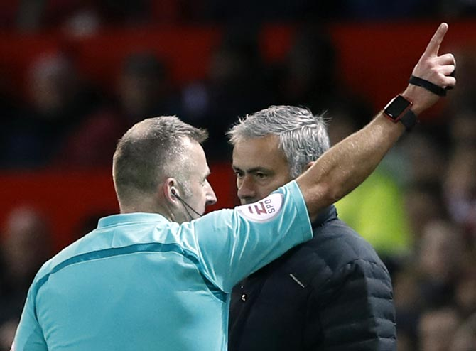 PHOTOS: Mourinho sent off on bad day for United; Arsenal win again