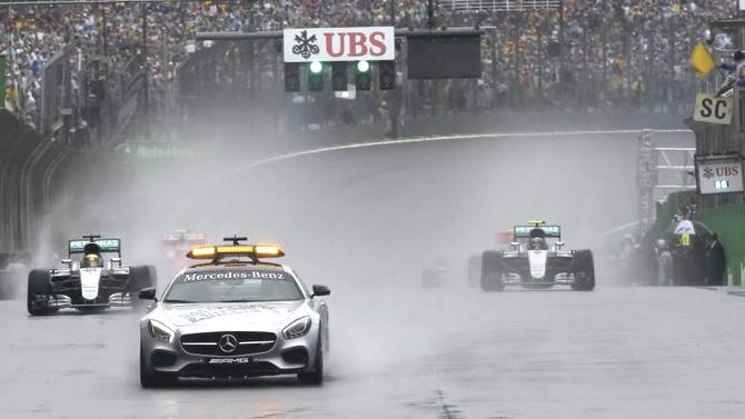 Mercedes' Lewis Hamilton of Britain (left) follows the safety car at the start of the Brazilian GP F1 race at the Circuit of Interlagos in Sao Paulo on Sunday