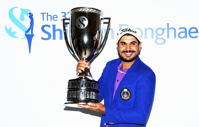 India's Ganganjeet Bhullar poses with the trophy after his win at the Shinhan Donghae Open in Incheon, South Korea on Sunday, for his sixth title on the Asian Tour