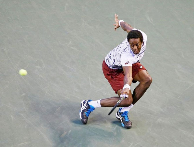 France's Gael Monfils returns a ball to Croatia's Ivo Karlovic during their men's singles quarters at the Ariake Coliseum, in Tokyo, on Friday