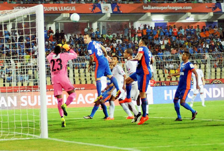 Players of FC Goa & Fc Pune City vie for the ball during their ISL match in Margao, Goa on Saturday.