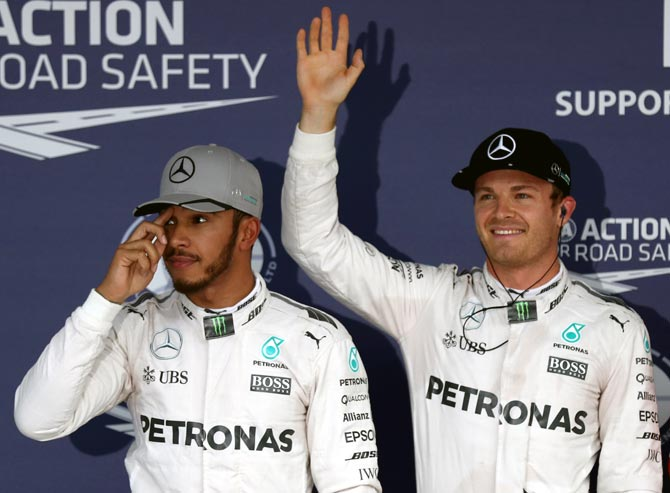 Rosberg fends off Hamilton to seize pole in Japan