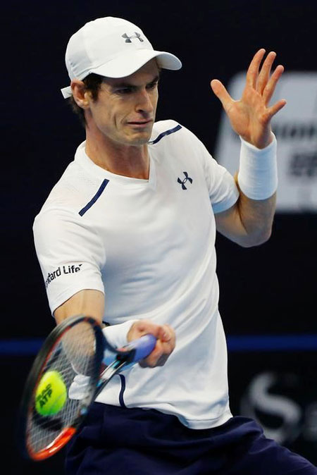 Britain's Andy Murray plays David Ferrer of Spain