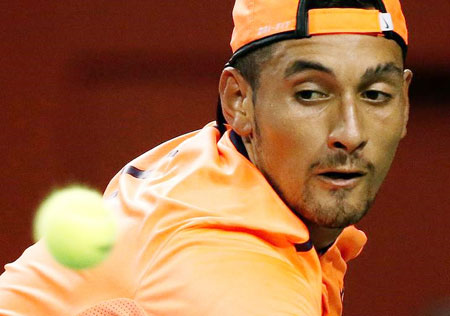 Australia's Nick Kyrgios returns the ball during the semi-final against France's Gael Monfils at the Japan Open on Saturday