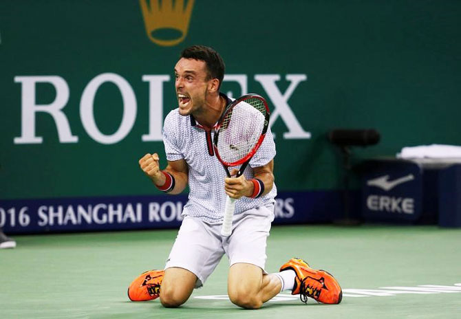 Bautista Agut reacts after defeating Novak Djokovic and entering the Shanghai Masters final on Saturday