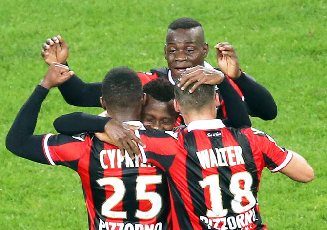 Nice's Jean Michel Seri (centre) celebrates after scoring a goal against Lyon during their Ligue 1 match at Allianz Riviera stadium in Nice, France on Saturday