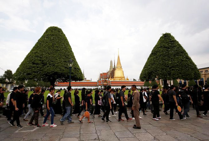 Mourners line up to enter the Grand Palace to pay respect to Thailand's late King Bhumibol Adulyadej in Bangkok on Saturday