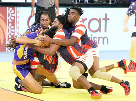 Player of USA kabbadi team catch a raider from Thailand during the Kabaddi World Cup 2016 match in Ahmedabad on Sunday