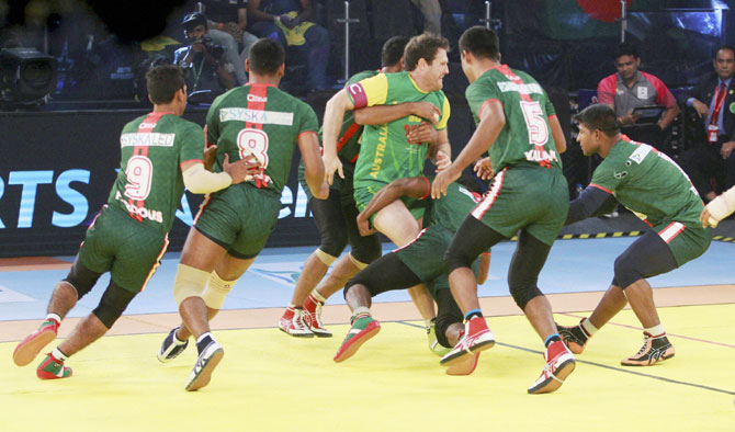 Bangladesh kabaddi team player catch raider of Australia kabaddi team player during kabaddi world cup match in Ahmadabad on Monday