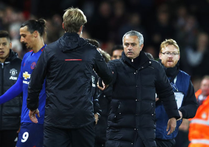 Liverpool manager Juergen Klopp and Manchester United manager Jose Mourinho at the end of the match on Monday