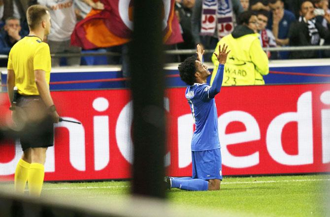 Juventus' Juan Cuadrado celebrates after scoring against Olympique Lyon at Stade de Lyon in Decines, France