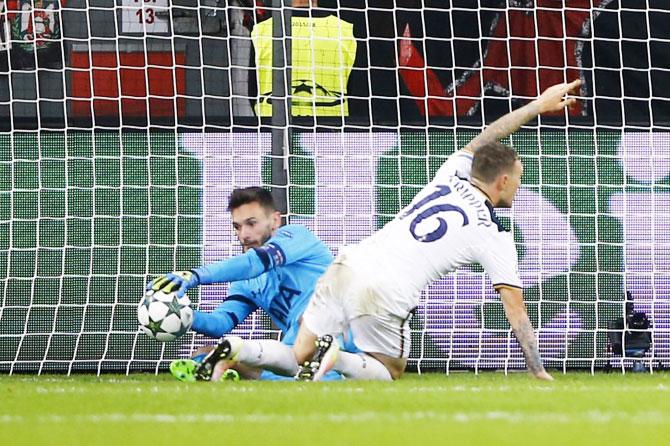 Tottenham's Hugo Lloris makes a save from Bayer Leverkusen's Javier Hernandez (not pictured)