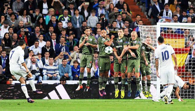 Real Madrid's Cristiano Ronaldo takes a free kick during the Group F match against Legia Warszaw on Tuesday