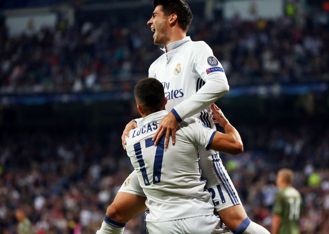 Rediff Sports - Cricket, Indian hockey, Tennis, Football, Chess, Golf - Champions League PIX: Five-star Real hammer Warsaw; Spurs held