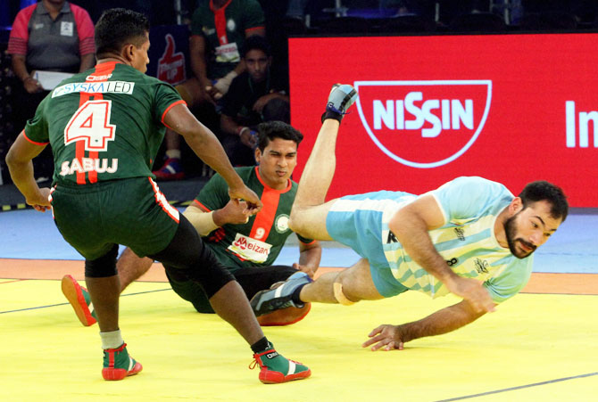 Bangladesh players catch a Argentina player during the Kabaddi World Cup in Ahmedabad on Wednesday