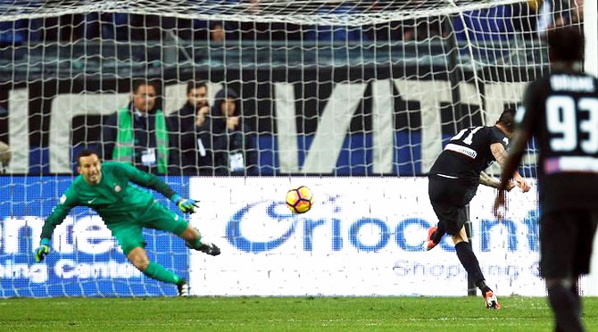Atalanta's Mauricio Pinilla shoots to score a penalty against Inter Milan on Sunday