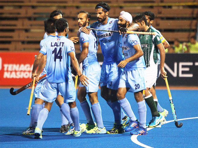 India's Rupinder Pal Singh celebrates with teammates after scoring the 2nd goal against Pakistan on Sunday