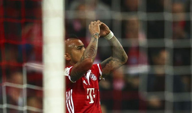 Bayern Munich's Arturo Vidal celebrates his goal against Borussia Moenchengladbach at the Allianz Arena in Munich on Sunday