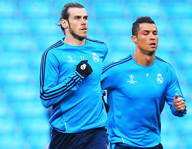Rediff Sports - Cricket, Indian hockey, Tennis, Football, Chess, Golf - Bale takes a dig at former Real Madrid teammate Ronaldo