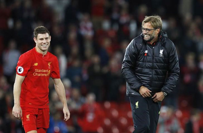 Liverpool manager Juergen Klopp celebrates with James Milner after the game