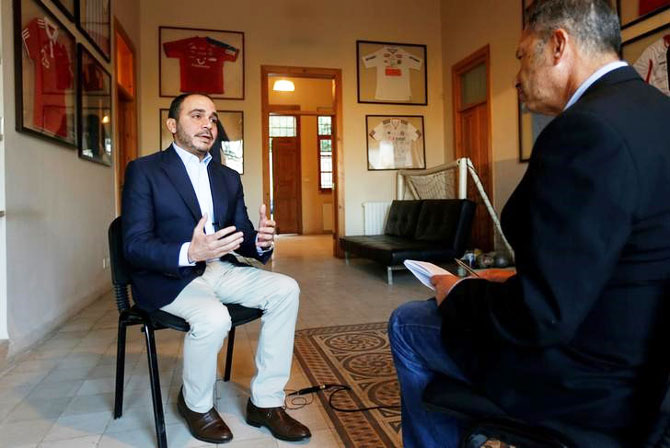 Jordan's Prince Ali Bin Al Hussein (left), president of the Jordanian Football Association, speaks with Reuters journalist Suleiman al-Khalidi during an interview, in Amman, Jordan