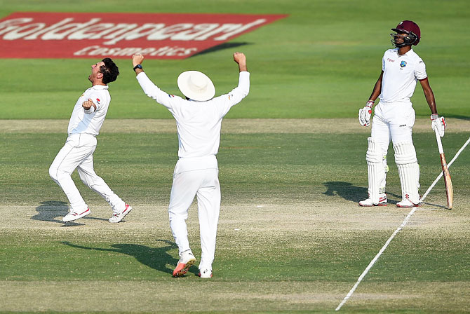 Pakistan's Yasir Shah celebrates taking the wicket of West Indies' Marlon Samuels on day 4 of the Second Test at Zayed Cricket Stadium in Abu Dhabi, United Arab Emirates, on Monday