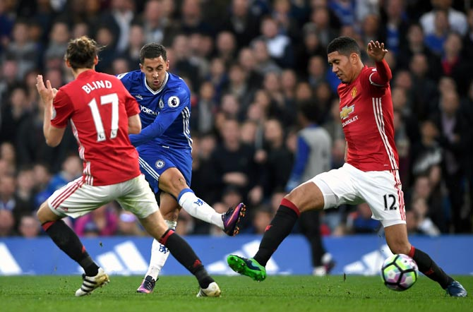 Rediff Sports - Cricket, Indian hockey, Tennis, Football, Chess, Golf - Nevilles slam Manchester United midfield 'mannequins', 'garbage defending'
