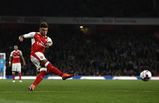 Rediff Sports - Cricket, Indian hockey, Tennis, Football, Chess, Golf - Transfer deadline day: Arsenal's Oxlade-Chamberlain to join Liverpool?