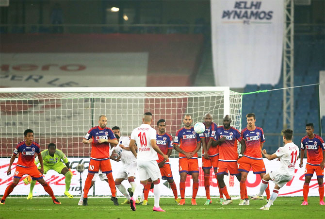 The Pune FC defence wall is all focus as Marcelo Pereira of Delhi Dynamos FC takes a free kick during their ISL match in New Delhi on Thursday