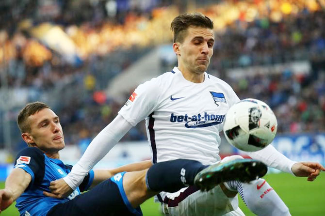 TSG 1899 Hoffenheim's Pavel Kaderabek and Hertha BSC Berlin's Peter Pekarik vie for possession during their German Bundesliga match at Wirsol Rhein-Neckar-Arena, Germany on Sunday
