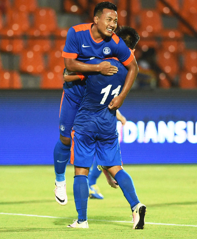 India's Jeje Lalpekhlua (left) celebrates with a teammate after scoring India's 3rd goal against Puerto Rico during their football friendly in Mumbai on Saturday