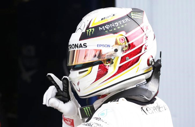 Lewis Hamilton celebrates qualifying in pole position for the Italian Grand Prix at the Autodromo Nazionale Monza, Italy on Saturday