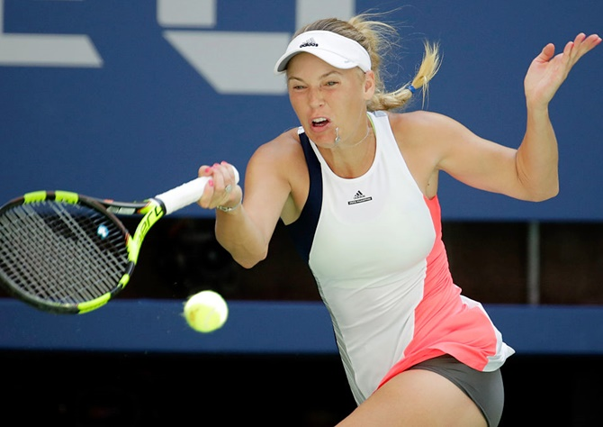 Rediff Sports - Cricket, Indian hockey, Tennis, Football, Chess, Golf - US Open PIX: Wozniacki drops Sevastova; Djokovic, Kerber also reach semis