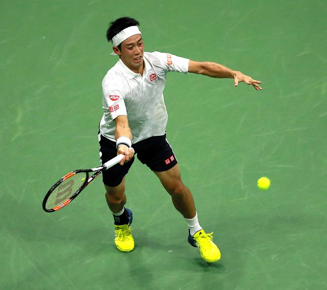 Kei Nishikori returns a shot during the semi-final match against Stan Wawrinka on Day 12 of the 2016 US Open