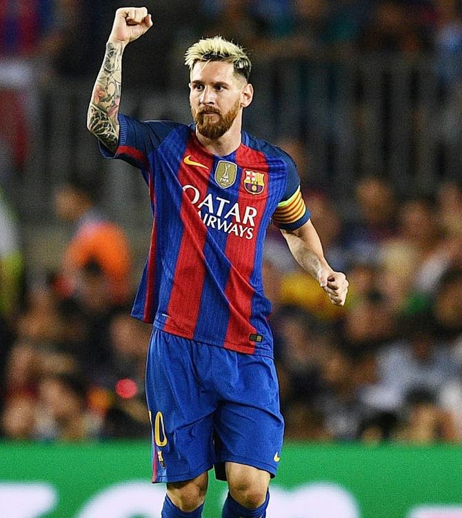 Image lionel messi of barcelona celebrates scoring photograph david